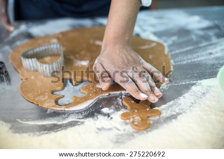 roll the dough and cut molds - stock photo