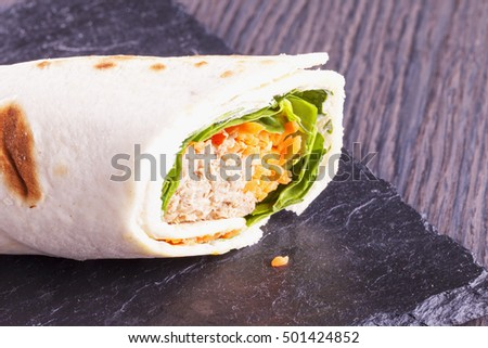 Roll with tuna and carrots, close up, horizontal image