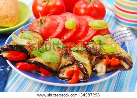 rolled aubergine slices stuffed with mozzarella and paprika