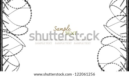 Rolled barbed wire. A place for sample text. - stock photo