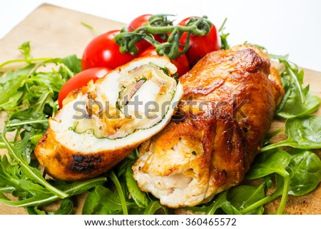 Rolled chicken. Stuffed chicken fillet with vegetables - stock photo