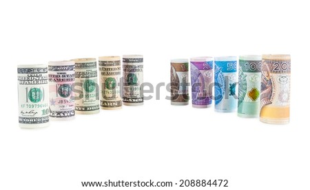 Rolled dollar and polish zloty banknotes isolated on white background with clipping path