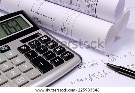 Rolled electrical diagrams, calculator and mathematical calculations for project,  drawings for the projects engineer jobs - stock photo