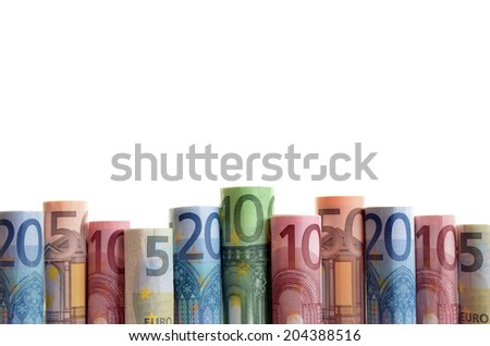Rolled Euro notes in a row - stock photo