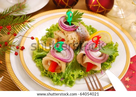 rolled herring fillets with paprika and onion for christmas - stock photo