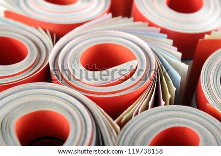 Rolled magazines background