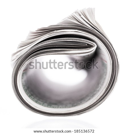 Rolled newspaper isolated on white background - stock photo