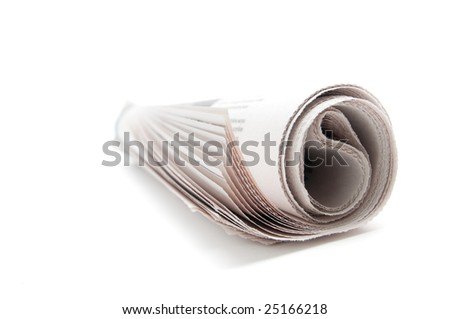 Rolled newspaper on white background