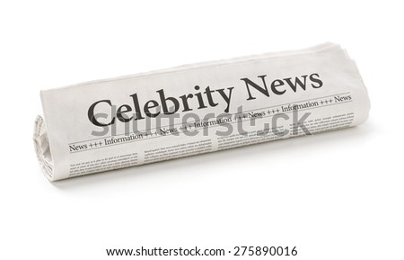 Rolled newspaper with the headline Celebrity News - stock photo