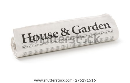 Rolled newspaper with the headline House and Garden - stock photo