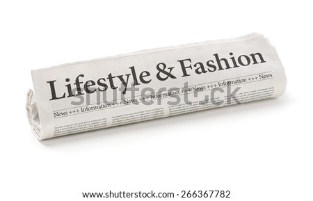 Rolled newspaper with the headline Lifestyle and Fashion - stock photo