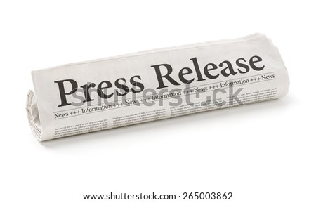 Rolled newspaper with the headline Press Release - stock photo