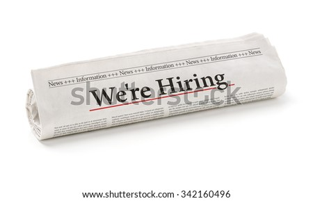 Rolled newspaper with the headline We are hiring - stock photo