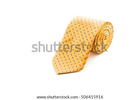 Rolled orange tie isolated on white background