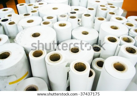 Rolled paper in printing house - stock photo