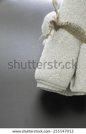 Rolled towels ready for hygiene use/rolled towels/Rolled towels with burlap string - stock photo