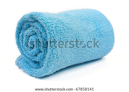 rolled up blue beach towel on  white background - stock photo