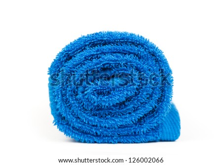 rolled up blue towel isolated on white - stock photo