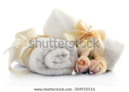 Rolled up colorful towels isolated on white - stock photo