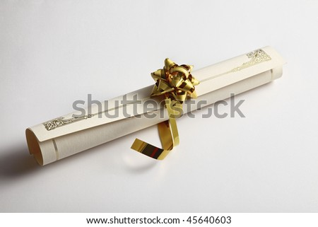 rolled up diploma with ribbon on the plain background - stock photo