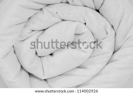Rolled up duvet. - stock photo