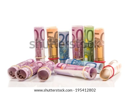 Rolled up Euro bills isoltaed background - stock photo