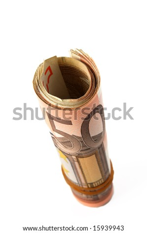 rolled up fifty euro bills in a slightly distorted perspective, shallow dof - stock photo