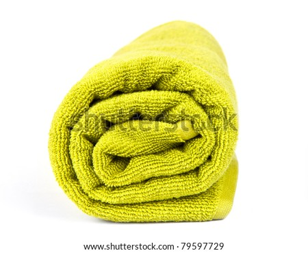 rolled up green towel isolated on white - stock photo