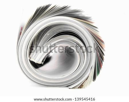 rolled up magazine - stock photo