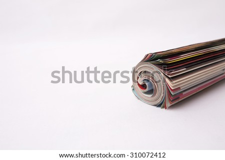 Rolled up magazine isolated on white background - stock photo