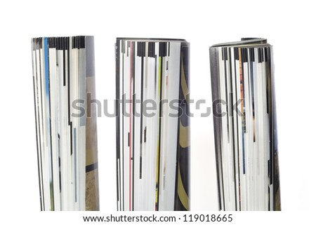 rolled up magazines, isolated, close up