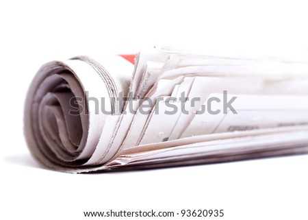 Rolled up newspaper isolated on white background. - stock photo