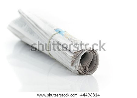 Rolled up newspaper with rubber band on white background - stock photo
