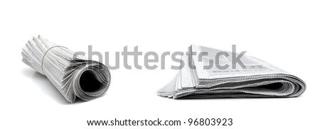 Rolled up newspapers isolated on white background - stock photo
