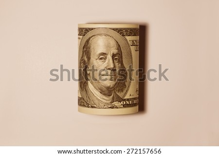 Rolled up one hundred dollar bill - stock photo