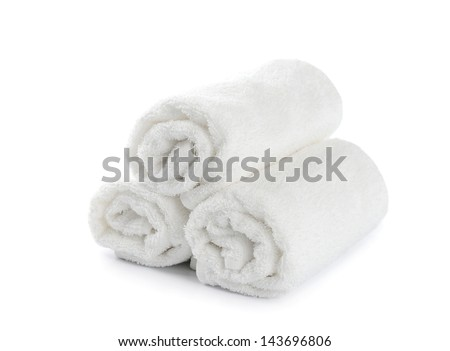rolled up white beach towel on  white background - stock photo