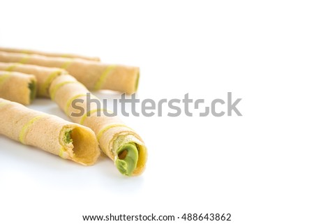 rolled wafer with milky green tea cream on white background.
