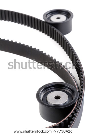 Roller and timing belt isolated on white - stock photo