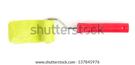 Roller brush with green paint isolated on white
