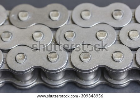 Roller chains for motorcycles - stock photo