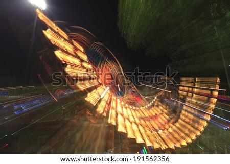 Roller coaster at night - stock photo