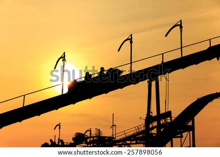 Roller Coaster in sunset - stock photo