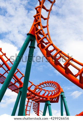 roller coaster on blue sky background