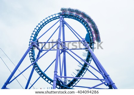 Roller Coaster ride at Theme Park - stock photo