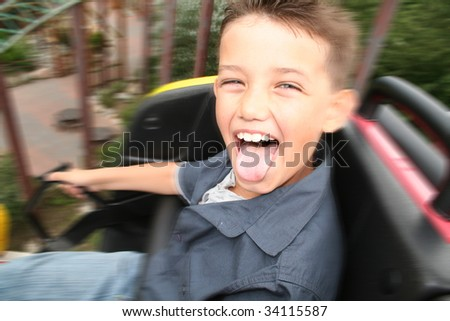 roller coaster ride. child screaming with joy in amusement park ride - stock photo
