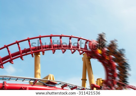 Roller coaster ride under blue sky with motion effect applied - stock photo
