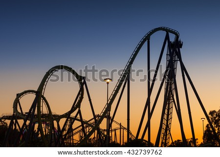 Roller Coaster Silhouette at Sunset - stock photo