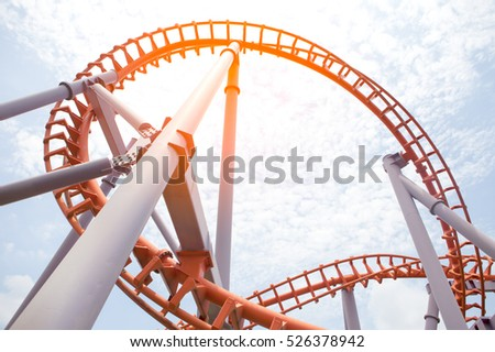 Roller coaster track blue sky at amusement park