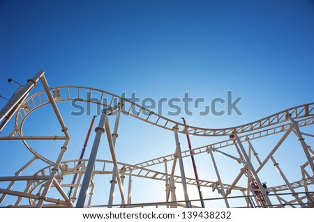 Roller-coaster with blue sky. - stock photo