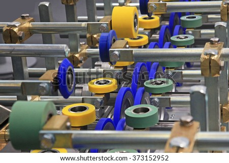 roller conveyor for furniture manufacture for forming furniture parts - stock photo